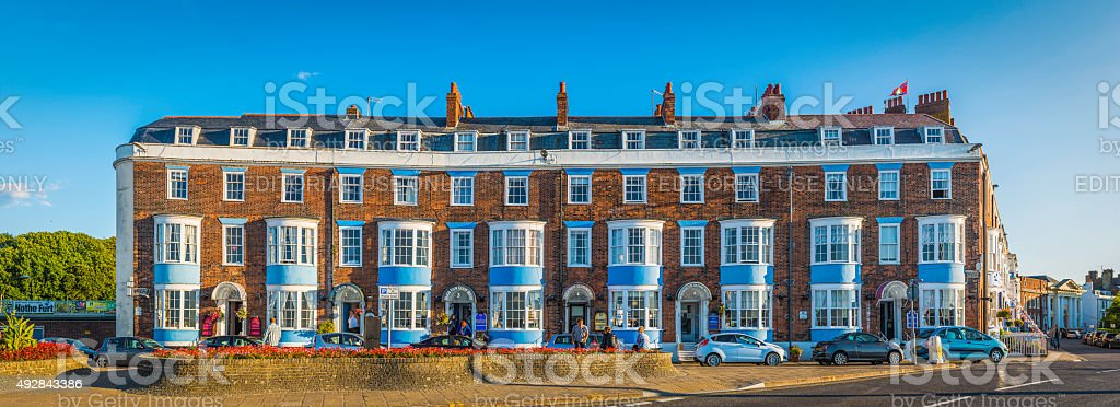 Seaside guesthouses bed and breakfast hotels summer holidays panorama England stock photo