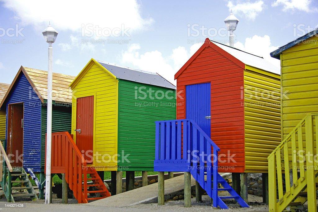 Sea-side rainbow cabins stock photo