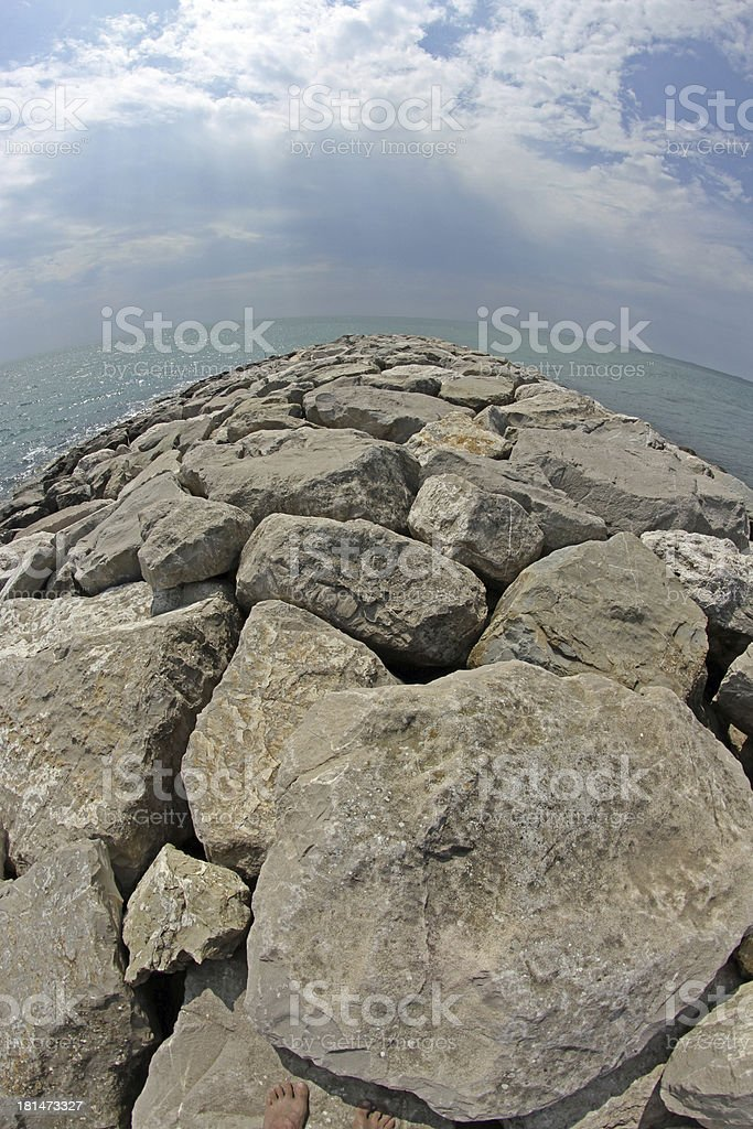 seaside rocks and breakwaters photographed with the fisheye lens royalty-free stock photo