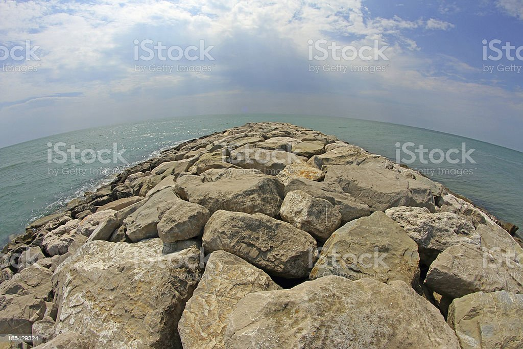 seaside rocks and breakwaters royalty-free stock photo