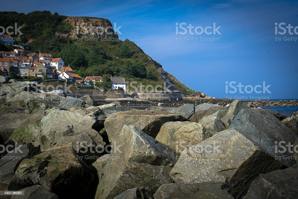 Seaside rocks and cottages stock photo