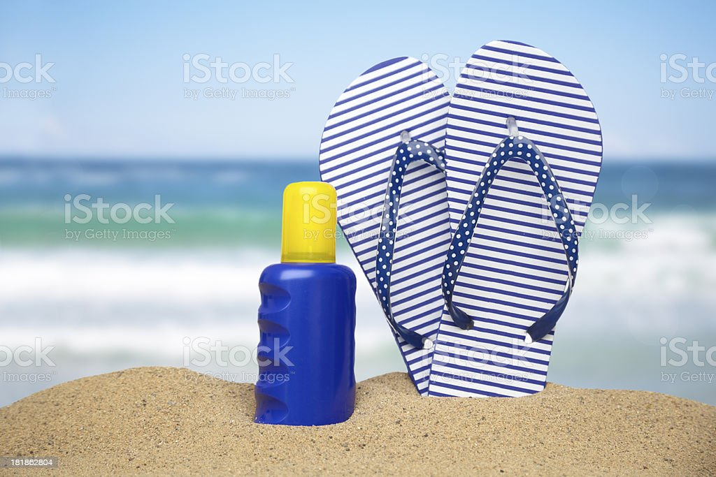 Seaside, sun lotion and flipflops royalty-free stock photo