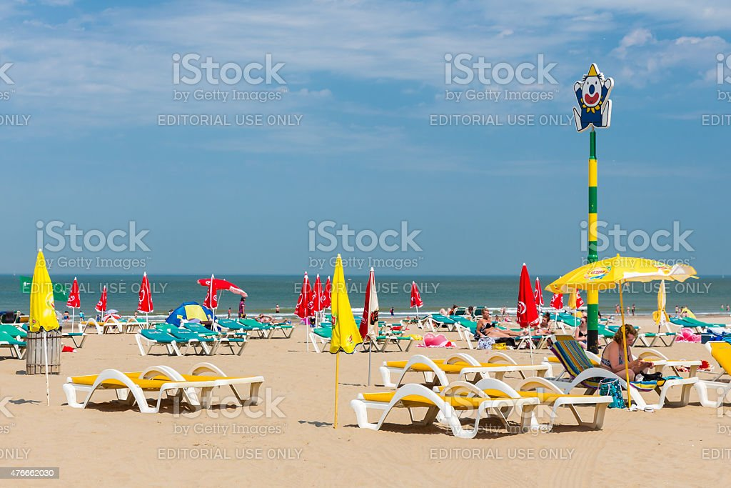 Seaside visitors relaxing at Dutch beach of Scheveningen stock photo