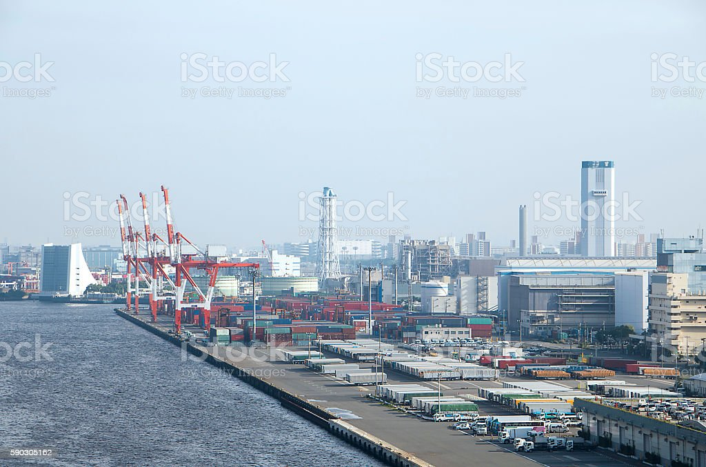 seaside warehouse and a lot of containers stock photo
