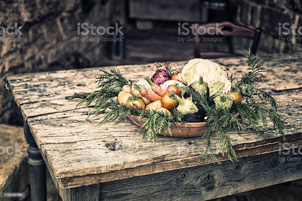 Seasonal vegetables on the table in a rustic farmhouse, Italy stock photo