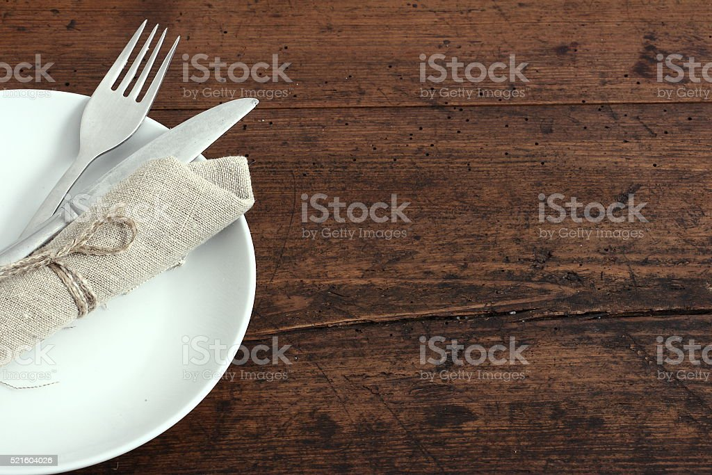 Seasonal white wooden table with cutlery stock photo