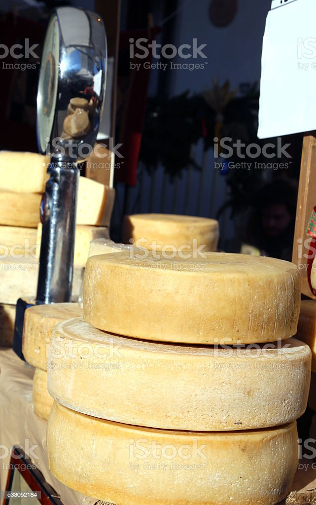 seasoned cheese and a balance in the local market stock photo