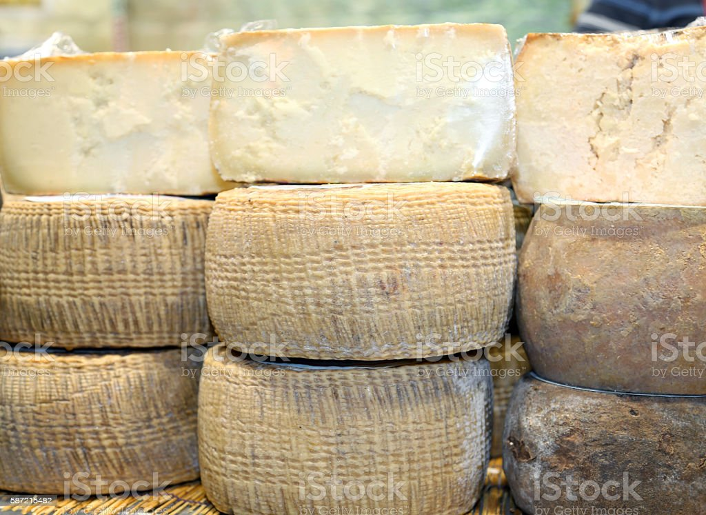 seasoned cheese made with cow's milk for sale in dairy stock photo