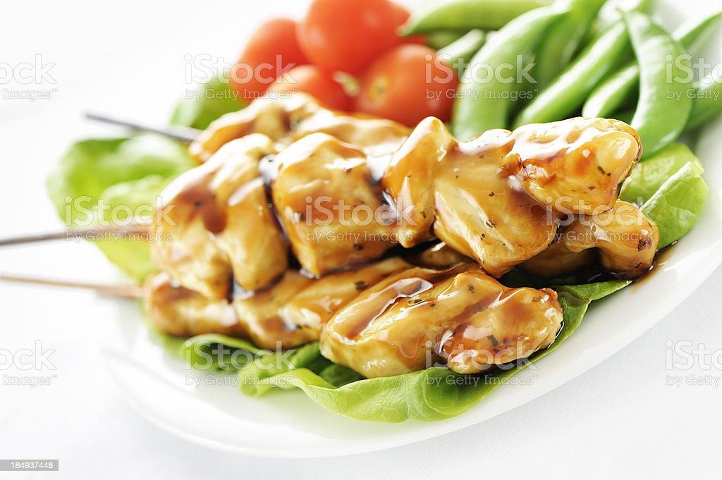 Seasoned chicken skewers stock photo