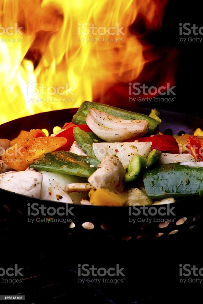 Seasoned Onions and Peppers on Grill royalty-free stock photo