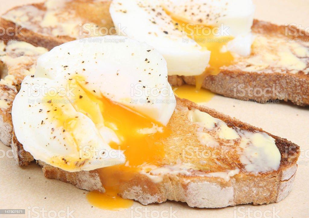 Seasoned poached eggs on toast stock photo