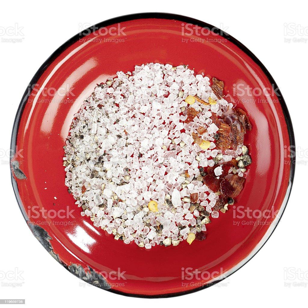 seasoned sea salt in enamel red plate, isolated stock photo