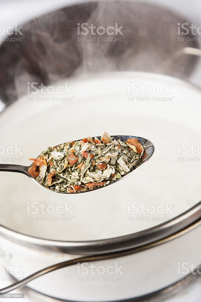 seasoning in spoon for cooking pot with steam royalty-free stock photo