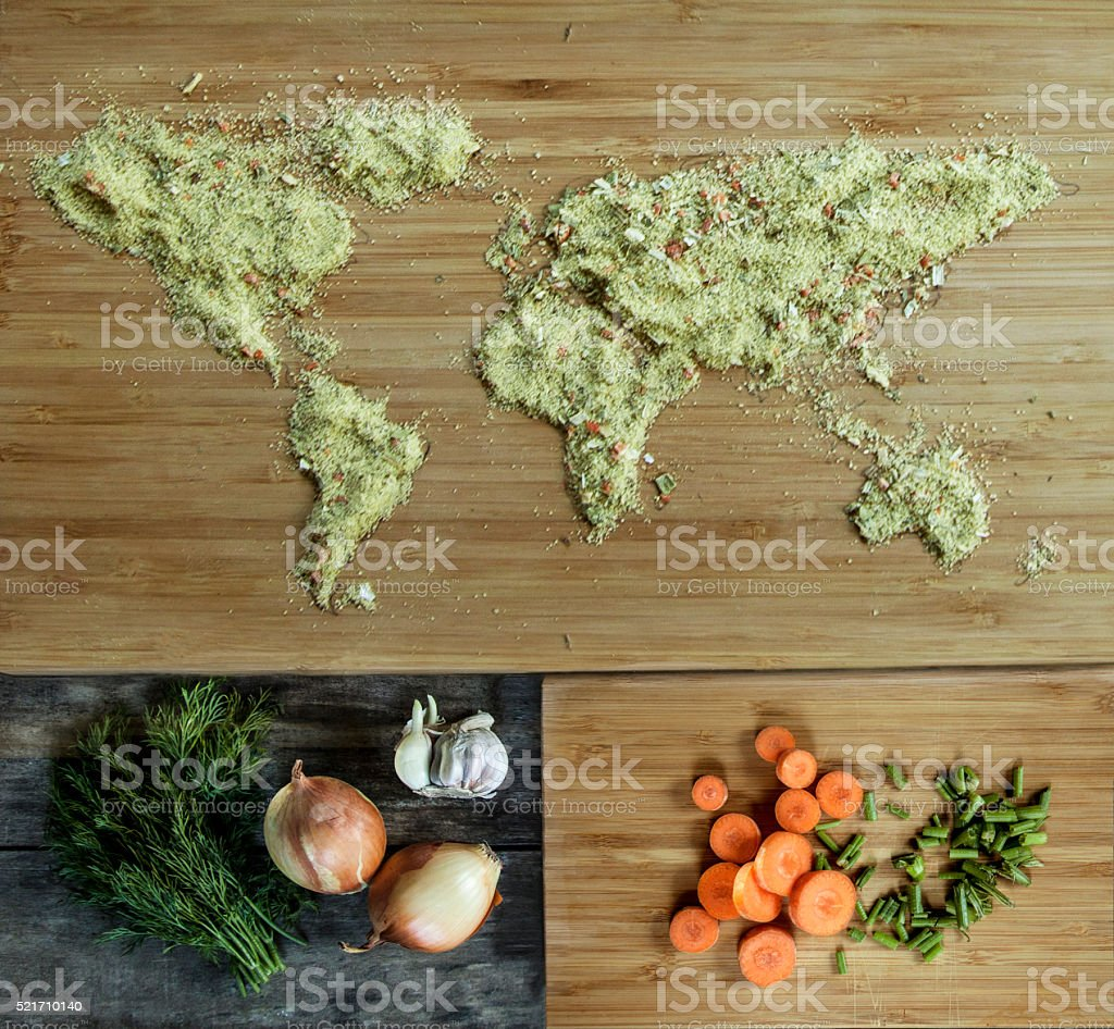 seasoning in the form of a world map, onions, carrots stock photo