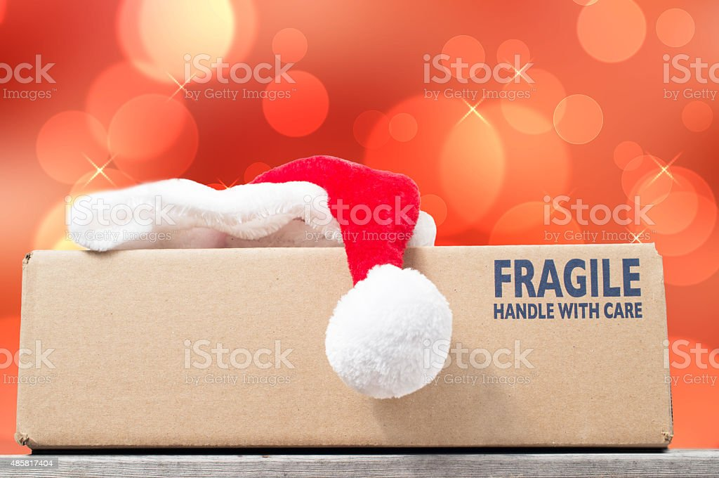 Season's Greetings with a Christmas purchase in a brown box stock photo