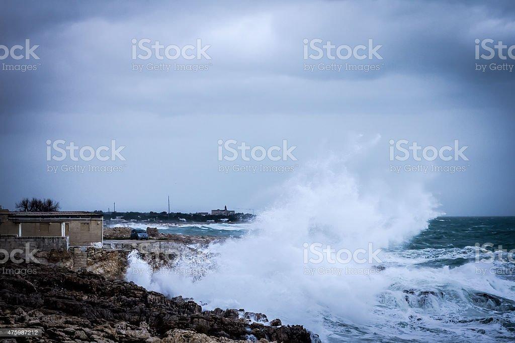 Seastorm at Polignano a Mare: waves on rocks stock photo