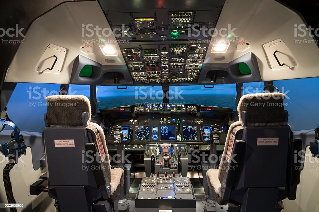 Seat and controller in cock pit of flight simulator stock photo