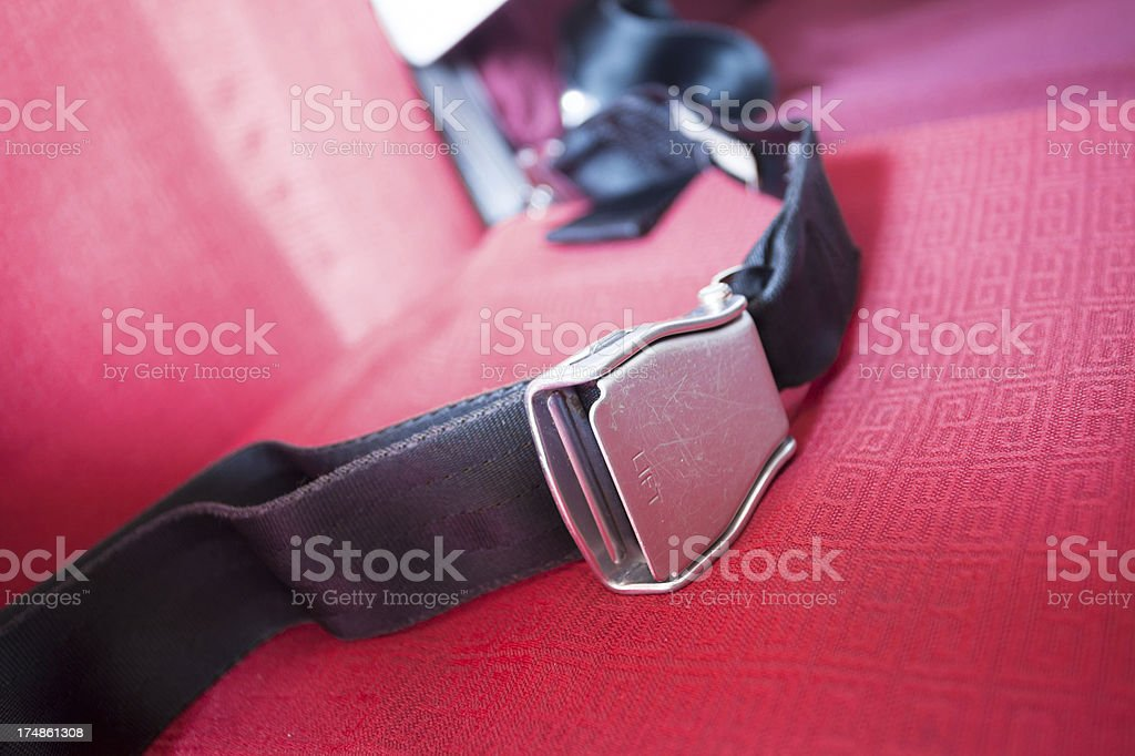 seat belt with red background shot in airplane royalty-free stock photo