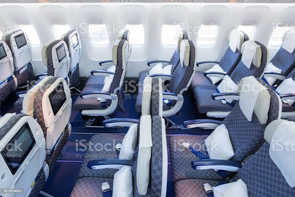 Seat rows in an airplane cabin stock photo