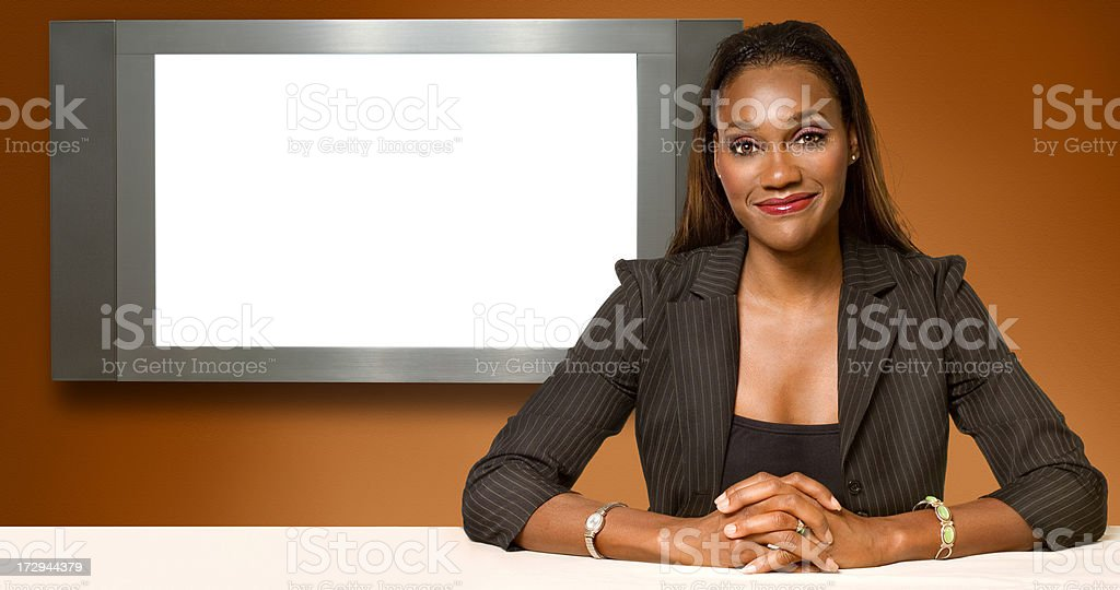 Seated at the screen stock photo