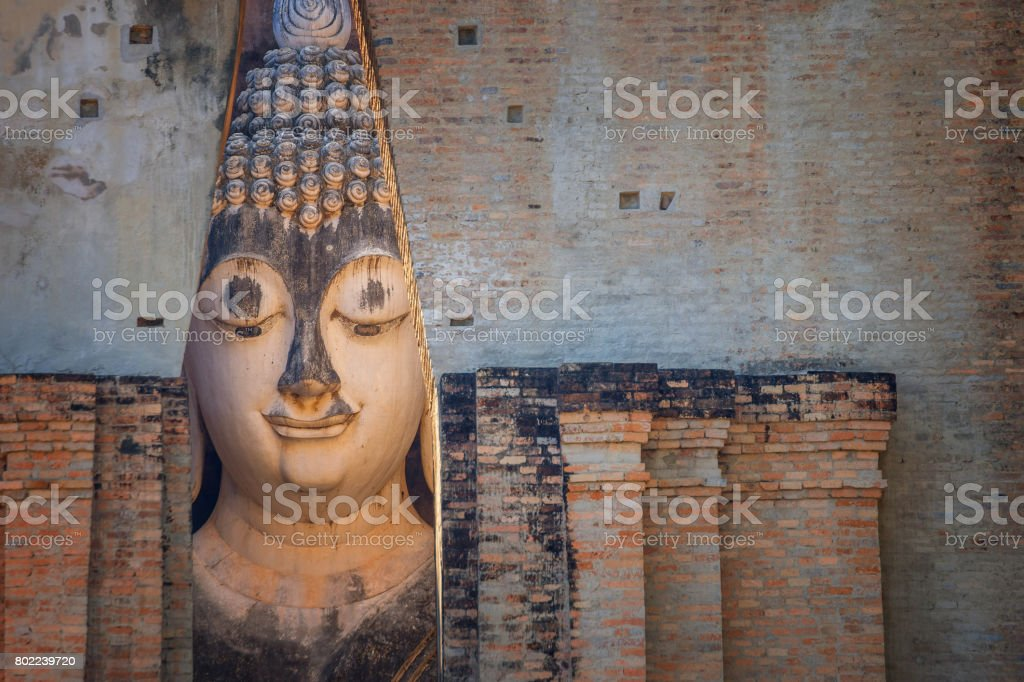 Seated Buddha image at  Wat Si Chum temple in Sukhothai Historical Park, a UNESCO world heritage site, Thailand stock photo
