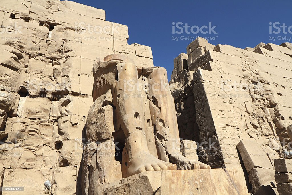 Seated Colossus, Great Temple of Amun, Karnak, Luxor, Egypt royalty-free stock photo