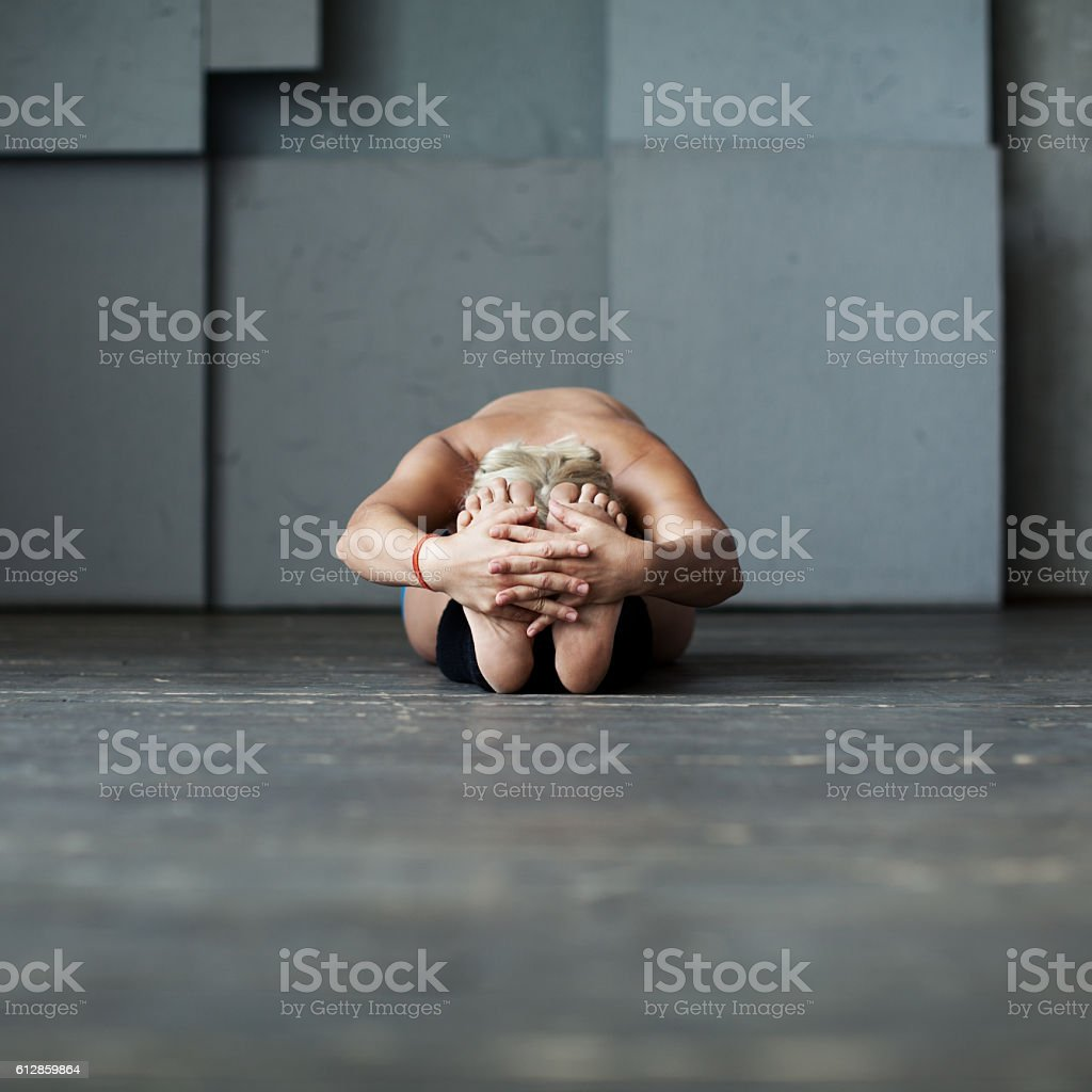 Seated Forward Bend stock photo