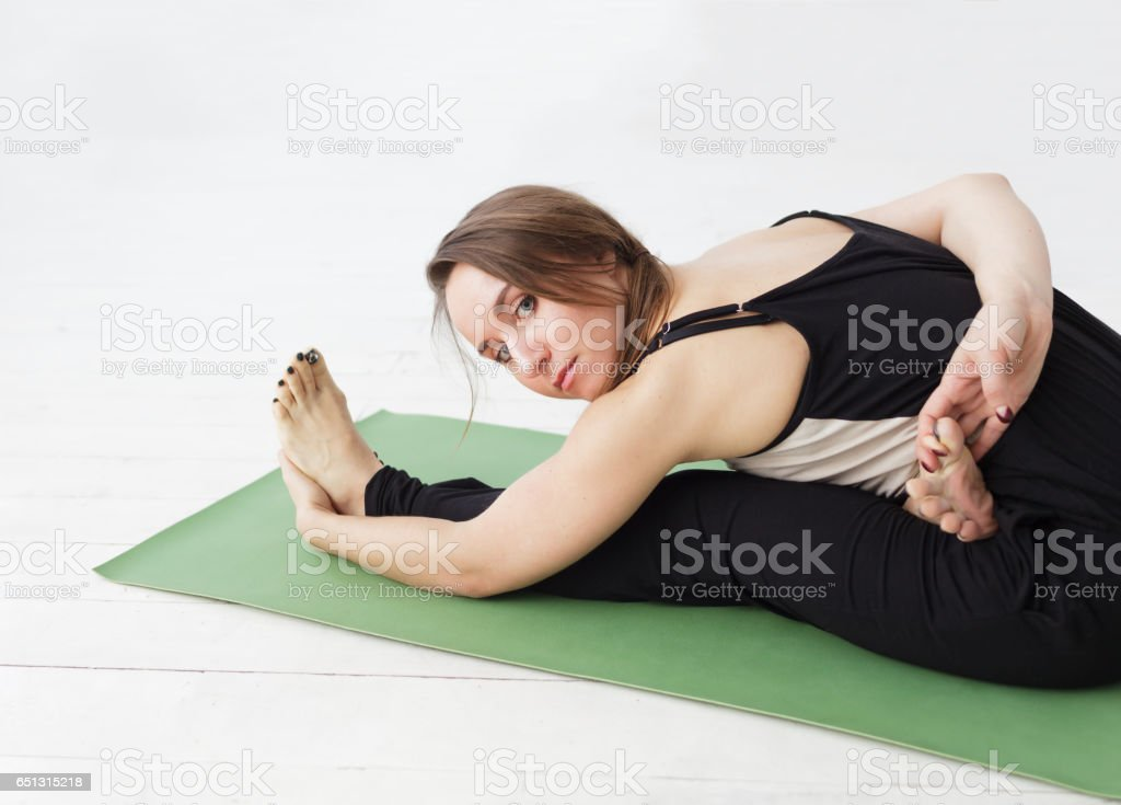 Seated forward bend. stock photo