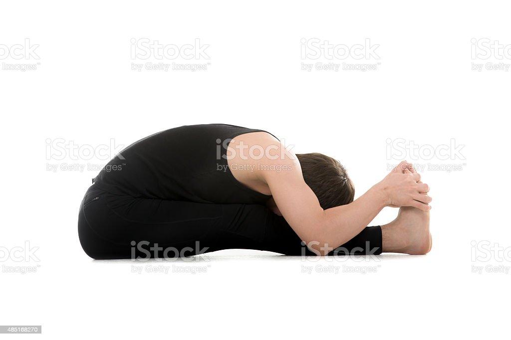 Seated Forward Bend yoga pose stock photo