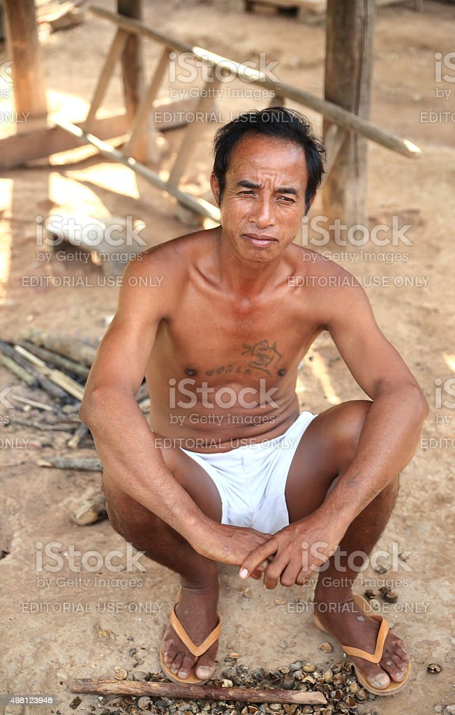 seated man-luang namtha-Laos stock photo