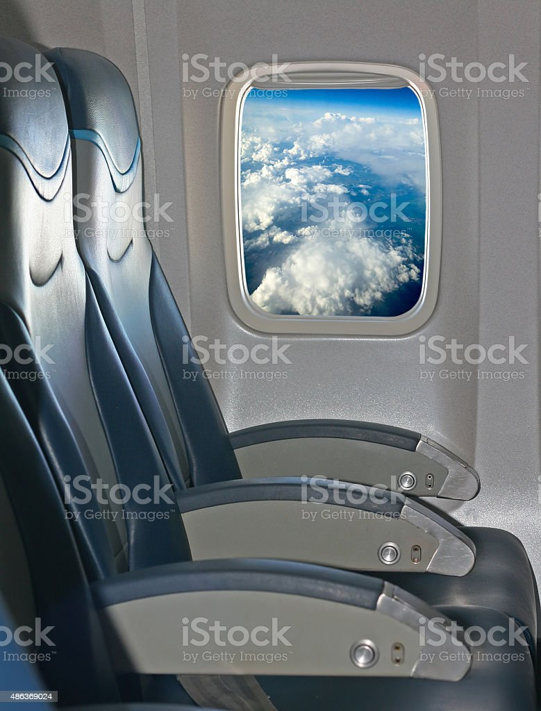 Seating and window inside an aircraft stock photo