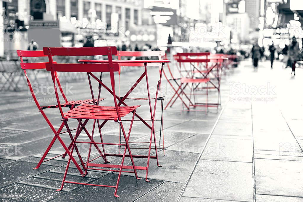 Seating area at plaza in busy Times Square NYC stock photo
