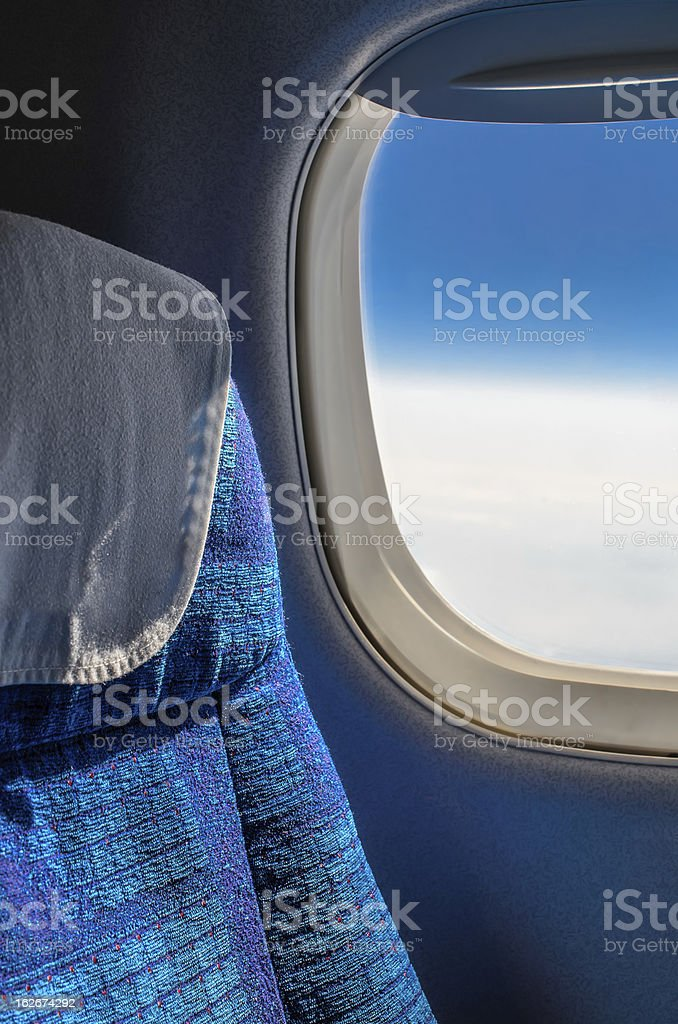 Seats and window in airplane royalty-free stock photo