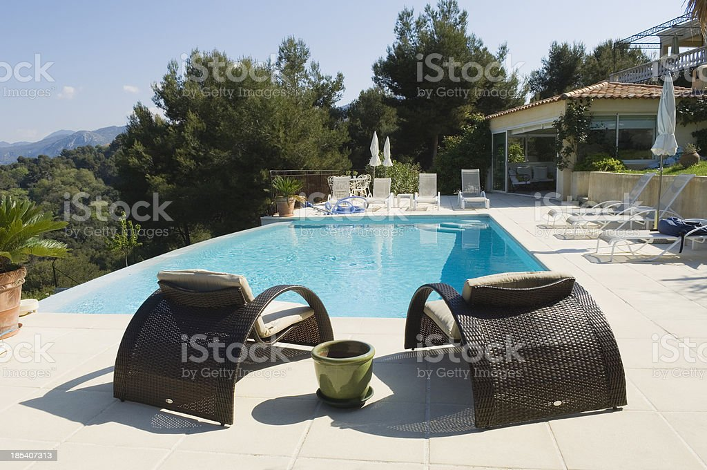 Seats by the pool royalty-free stock photo