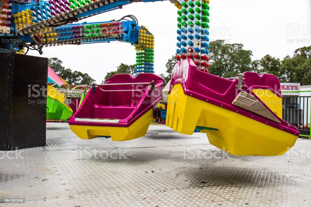 Seats On Spinning Ride stock photo