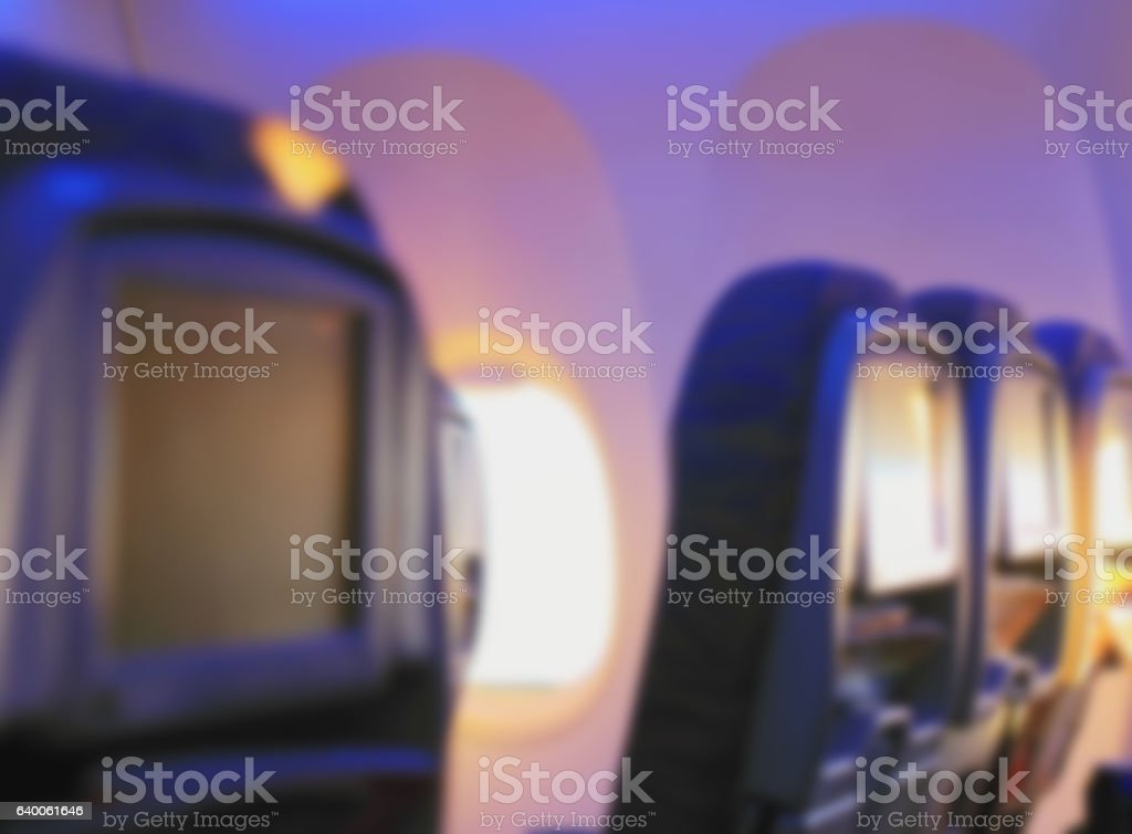 seats on the plane in sunny svte with magazines stock photo