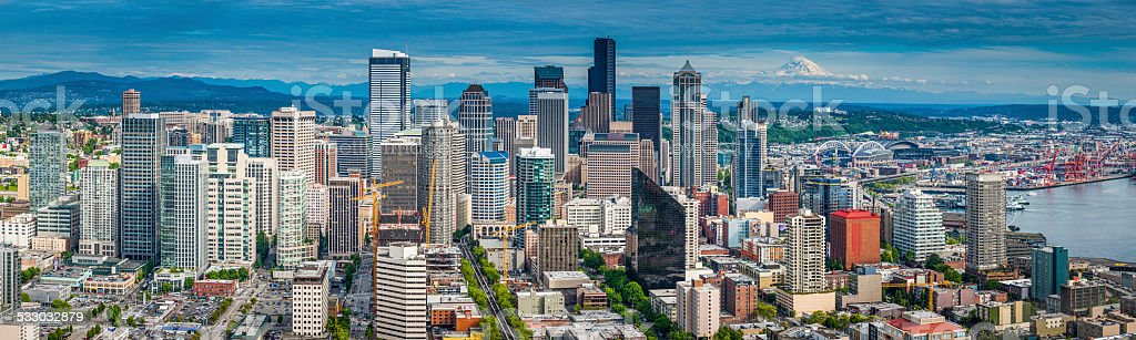 Seattle downtown skyscrapers crowded cityscape and harbor Mt Rainier Washington stock photo
