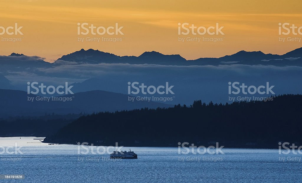 Seattle Ferry and the Olympic Mountains. stock photo