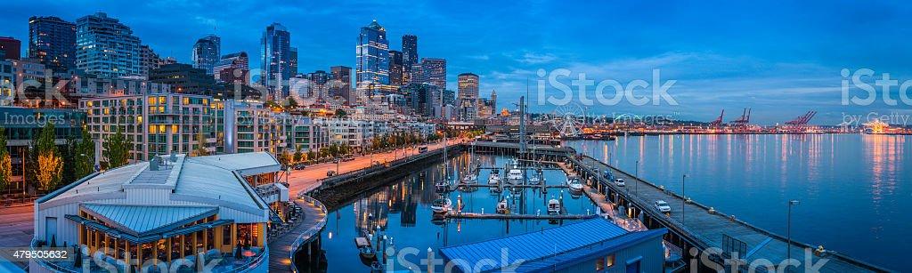 Seattle harbor waterfront apartments skyscrapers illuminated dusk panorama Washington USA stock photo