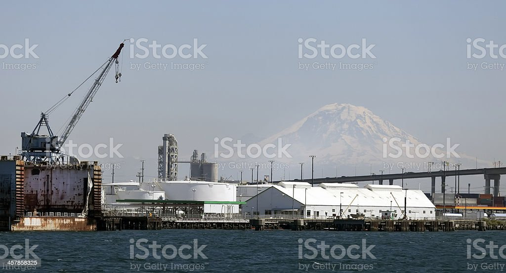 Seattle Harbor with crane - Mount Rainier in background royalty-free stock photo