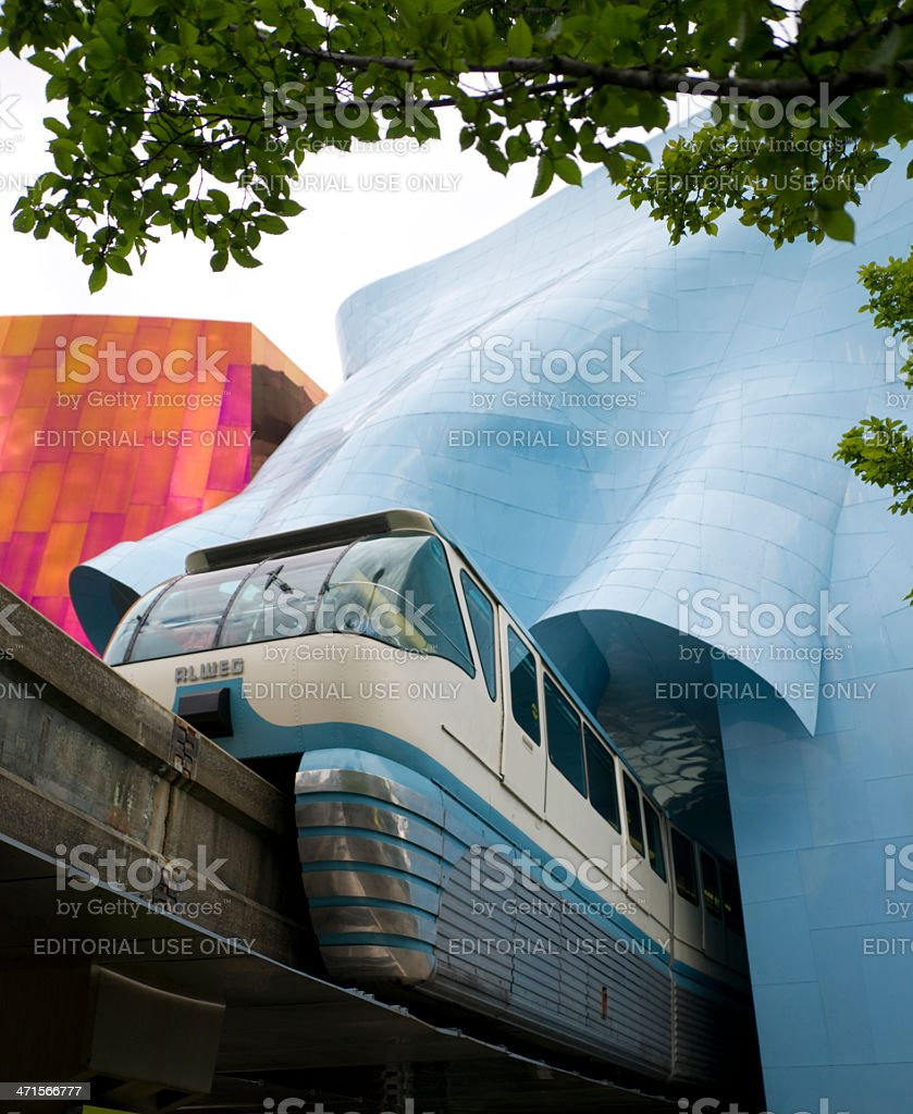 Seattle Monorail Emerges after Traveling Through Experience Music Project stock photo