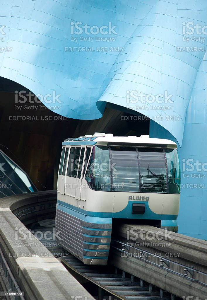 Seattle Monorail Train Emerges Traveling Through Experience Music Project stock photo