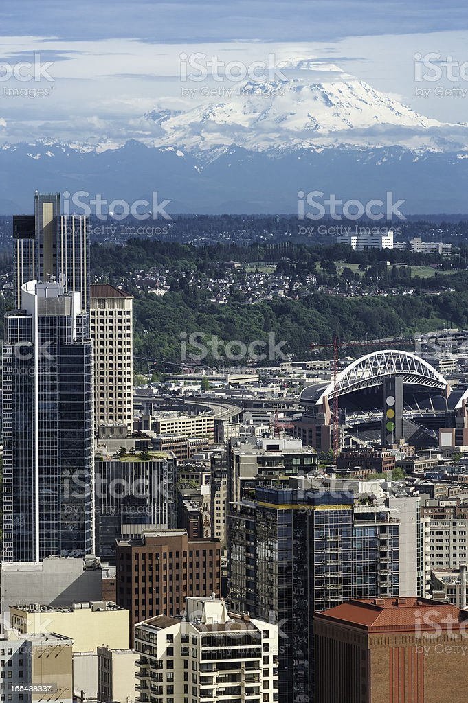 Seattle Mt Rainier towering over downtown skyscrapers stadiums stock photo