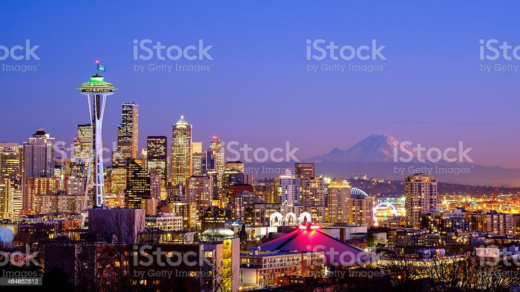 Seattle skyline at night with Mt Rainier in the distance  stock photo