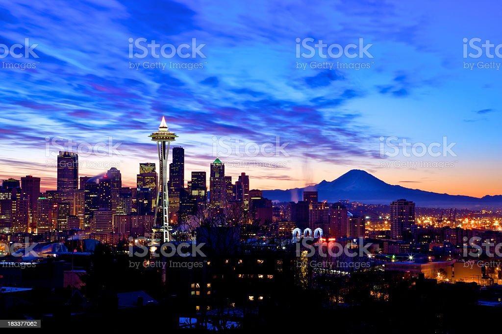 Seattle skyline lit up at sunset stock photo