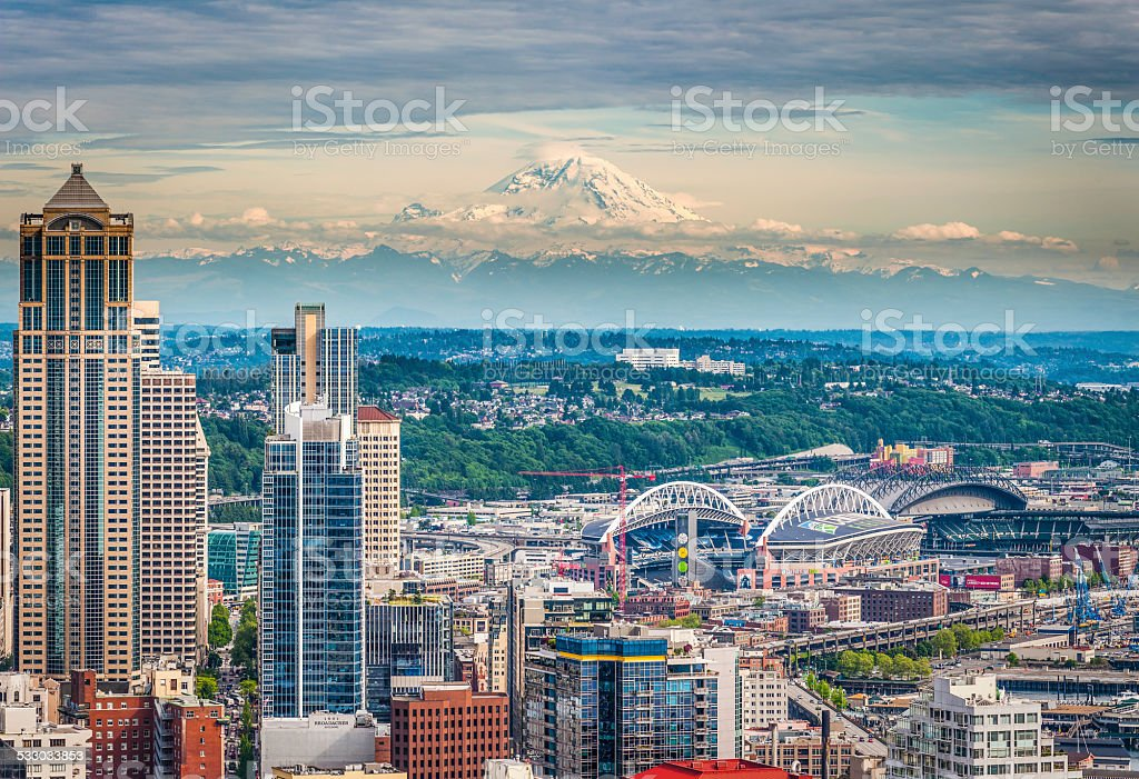 Seattle skyscrapers downtown cityscape overlooked by Mt Rainier Washington USA stock photo