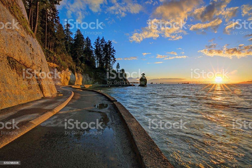 seawall and rock wall at sunset stock photo