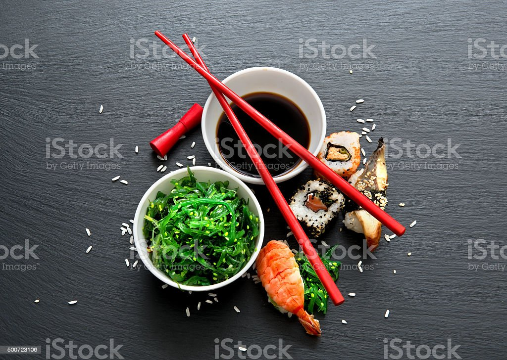 Seaweed salad and sushi stock photo