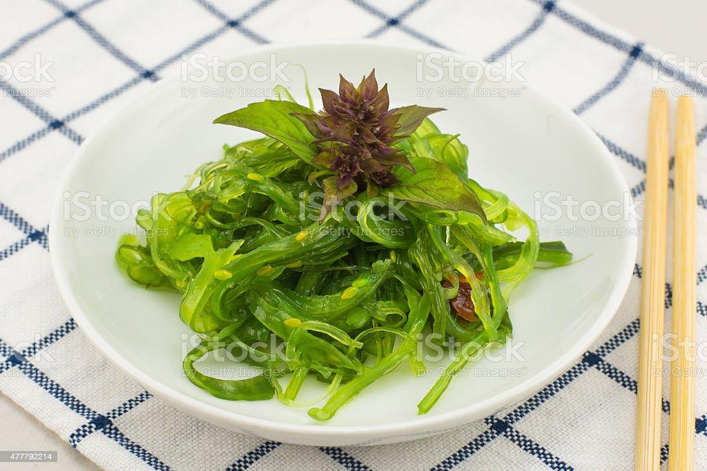 Seaweed salad - healthy sea food in the dish. stock photo