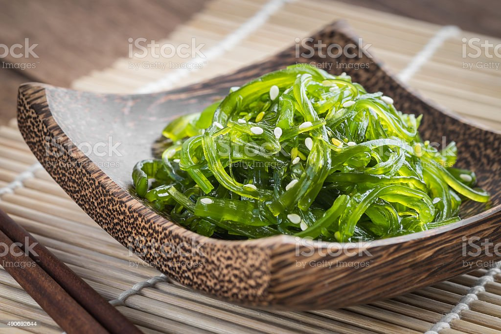 Seaweed salad on wooden plate, Japanese cuisine stock photo